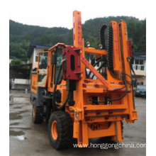 Highway guardrail piling/drilling rig